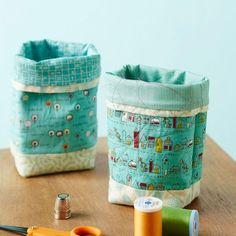 Keep your sewing space neat (and stylish!) with a cute thread catcher.Fabrics are from the Road 15 collection by Sweetwater for Moda Fabrics.