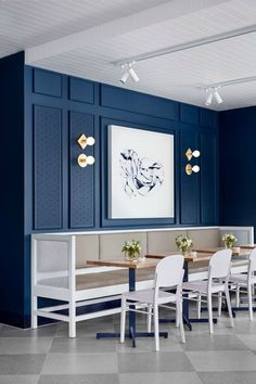 Middleton Cafe in Prahran Melbourne blue feature wall with gold lighting and white furniture