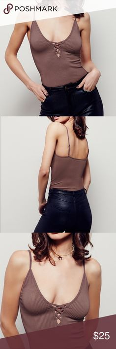Free People Crossfire Cami in Natural SIZE IS XS/S OR M/L. BRAND NEW WITH TAGS! American made layering cami in a stretchy textured rib fabrication, features a plunging V-neckline with crisscross detailing. Adjustable straps.  8% Spandex 92% Nylon Machine Wash Cold Made in the USA Free People Tops Camisoles