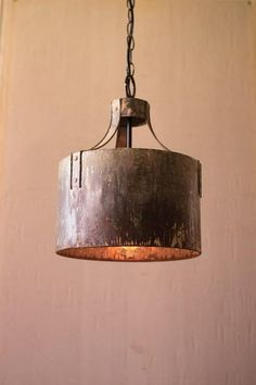 Kalalou Metal Cylinder Pendant Light - Rustic metal riveted arms clamp to a cylindrical pendant creating industrial light and more than a little magic. Pair two or more over a workspace or kitchen island. Cylinder Pendant Light, Metal Drum, Industrial Lighting, Rustic Light Fixtures, Rustic Metal, Rustic Pendant Lighting, Rustic Chandelier, Pendant Light Fixtures, Metal Chandelier