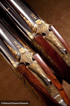 This exquisite pair of J. Purdey & Sons over and unders are vent ribbed guns with two sets of barrels for each gun for a total of four barrels, single triggers. The pair has highly figured stocks with leather covered pads and horn accessories. Engraved by Purdey master engraver Ken Hunt.