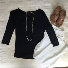 Ann Taylor Silky Front Navy Top Size M Anne Taylor Silky Front Top in Navy Blue. 3/4 length sleeves. Great condition! Offers welcome!! White capris pictured also listed for sale in my closet. Ann Taylor Tops Blouses