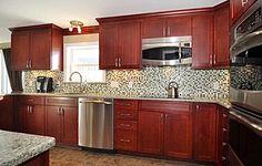 Norcraft Cabinetry in Maple Shaker Style Kitchen Cabinet,Glass Mosaic Backsplash, Stainless Steel Appliances, Quartz Stone countertop and Tiled Kitchen floor. #RhodeIslandKitchen www.cypressdesign.com