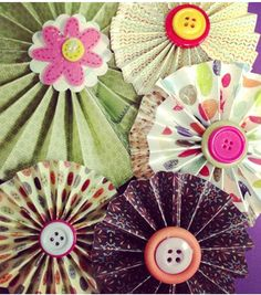 Learn to make paper rosettes!  Cute idea for so many craft projects! #creativitymadesimple