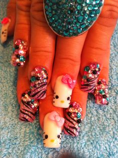 Oooh @Lisa Phillips-Barton Phillips-Barton Phillips-Barton Phillips-Barton James hello kitty nails!!!
