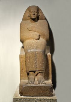 Quartzite statue of Ankhrekhu, a Middle Kingdom official wearing a cloak, 12th Dynasty, 1985-1795 BC. British Museum