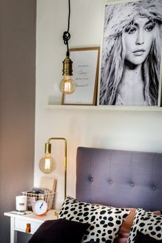 A grey headboard, and industrial style lighting with copper and brass from Olivia's home
