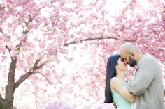 A dreamy spring cherry blossom engagement session at the Brooklyn Botanical Garden // photo by Mikkel Paige.
