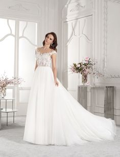 ca4d4592bac5 Demetrios - Wedding Dress Style 840   Sprays of floral embroidered lace  adorn the bodice of