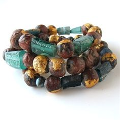 Buddha beads - The ones with gold leaf are made by monks, with the image of the seated Buddha rolled into them.