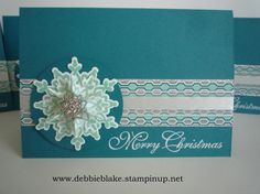 Festive Flurry card - Festive Flurry and Greetings of the Season Stamp Sets. Festive Flurry Framelits. Winter Frost Stack. Frosted Finishes Embellishments. Island Indigo and Whisper White Cardstock. Silver Glimmer Paper. Organza Ribbon. White Emboss Powder.