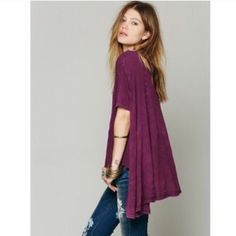 Free People Purple Circle in The Sand Tee Great relaxed tee that is shorter in the front but long and cape like in the back. Material feels like a dream and has a wonderful faded worn in look to the purple. Perfect addition to your closet for Spring! COLOR NO LONGER AVAILABLE ONLINE! Free People Tops Tees - Short Sleeve