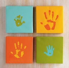 4 contrasting colors, 4 square canvases  (Instead of hands you could use a stencil, stamps, negative images, or letters)