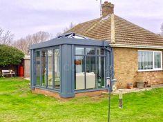 A modern grey aluminium loggia style conservatory on a bungalow near Peterborough House Extension Design, Extension Designs, Extension Ideas, Bungalow Extensions, House Extensions, Modern Conservatory, Peterborough, Front Porch, Gazebo