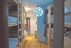 Sleeping area: A dorm at #TattvaDesignHostel #Oporto!  #Design #Bunkbeds #bunkdesign #designideas #lamps #bluelamp #blueideas #wooddesign #woodbunkbed #woddenbed #hosteling #hosteldesign #designhostel