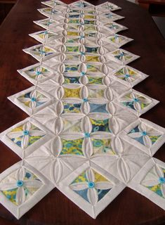 Cathedral Window Table runner all hand sewn by kirpafabrics, $200.00 A special month for the QQQ Contest. It's our Anniversary / Birthday in April and so the entries are for such occasions! We're looking for the perfect gift :-) WOW Exquisite!