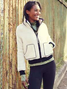 Northern Lights Jacket | Cozy faux fur jacket ideal for any workout during the colder seasons. Features a simple sporty design with side pocket details. Contrast ribbed fabric at the waist band and sleeve cuffs for an easy fit. Front zipper closure.