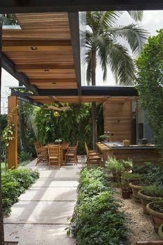 I guess this gorgeous walkway is in a tropical zone where there is a rainy season. I don't think I need one but I want one.