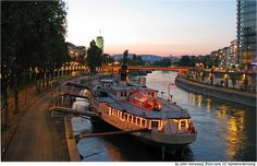 Enjoy a summer evening in Vienna, Austria taking a walk along the Donaukanal (Danube canal) and have a drink in one of the bars along the canal.  #austria #vienna #danube #canal #summer #sunset #visitaustria
