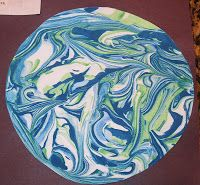 Marble painting Earth with shaving cream and paint