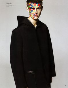 I choose this image because of the makeup. His face is very colorful and I like the design on his face.