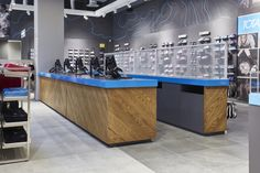 Emphasis was placed on the footwear wall with specific focus on flexibility through the use of a custom peg wall system. By introducing glorifier boxes on the peg wall, various feature products can be displayed alongside brand specific magnetic graphics.