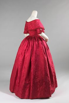 ~ca. 1842. This is a striking example of how 18th-century fabric was treasured. The textile was probably originally a 1740s dress which was taken apart and then reconfigured into this fashionable dress in the early 1840s. The elongated waist and V-shaped bodice front emphasize the bust and wide shoulders and were key features of the dresses of the period~