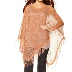 """Frosting by Mary Norton Knit All Season Poncho Spice up your look with this fun piece. Super lightweight and sheer for a sexy off the shoulder look, or wear over any top for a delicate finishing touch! Perfect layering piece in a dessert tan color.  ᴍᴇᴀsᴜʀᴇᴍᴇɴᴛs ᴡʜᴇɴ ғʟᴀᴛ: Neck Opening: 17"""" Shoulder to Base-hem: 30"""" Frosting by Mary Norton Sweaters Shrugs & Ponchos"""