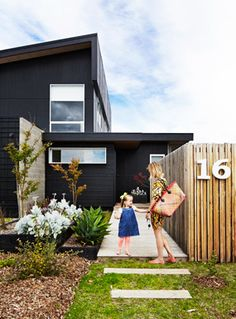 Exterior paint color on pinterest black house wood for Big modern house numbers