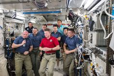https://flic.kr/p/yrcWT1 | iss044e086857 | ISS044E086857 (09/05/2015) --- Cosmonaut Gennady Padalka (center in red shirt) handed command of the International Space Station to NASA astronaut Scott Kelly (front left with microphone) on Sept. 5, 2015. In the background the rest of the space station crew was on hand (from left to right): ESA(European Space Agency) astronaut Andreas Mogensen (back),  Russian cosmonauts Mikhail Kornienko, Sergey Volkov and Oleg Kononenko, Kazakh cosmonaut Aidyn…