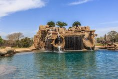 Grotto has waterfall, double water slides, spa and bar.