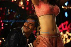 Actresses HQ Pics: Tamanna Hot Navel Show in Himmatwala