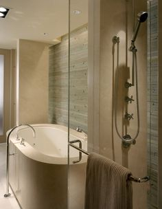 Like the openness of the glass shower wall but the practicality of the wall to hide the plumbing (at least that's what I'm assuming)