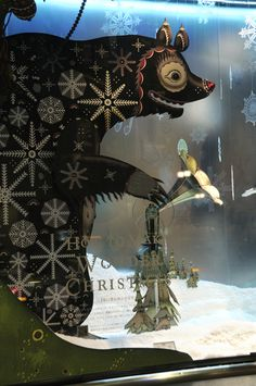 Isetan window: Japan by Klaus Haapaniemi 2009. I like the way they created a lot of depth by having things on the window, near, and far.