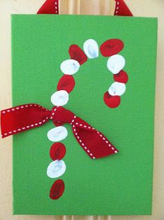 "Candy Cane Fingerprint Craft tutorial - includes link to free printable ""The Legend of the Candy Cane"""