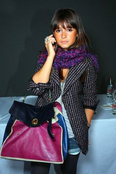 I like that her scarf and bag complement each other.