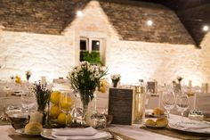 Long tables embellished with hessian table clothes, maison jars with lemons, candles and country flowers.