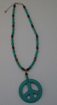 A personal favorite from my Etsy shop https://www.etsy.com/listing/116964010/green-turqouise-brown-tigerseye-peace