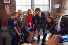 Author of Rizzoli and Isles Tess Gerritsen with the cast doing the famous dead body point on set. Maura Isles, Tess Gerritsen, Tv Show Casting, Angie Harmon, Police Detective, The Mentalist, Great Tv Shows, Best Shows Ever, Powerful Women