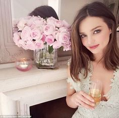 Picture of elegance! Miranda Kerr toasted her new Royal Albert stemware range in an elegant snap posted to Instagram on Wednesday, displaying subtle cleavage for good measure