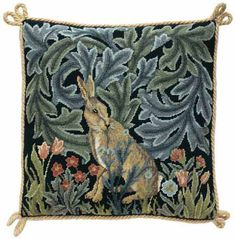 Cushions with William Morris designs from his Forest tapestry done in 1887