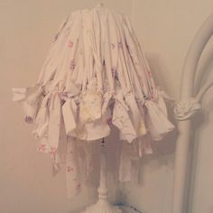 Lampshade makeover using vintage pillowcases ( torn into strips)