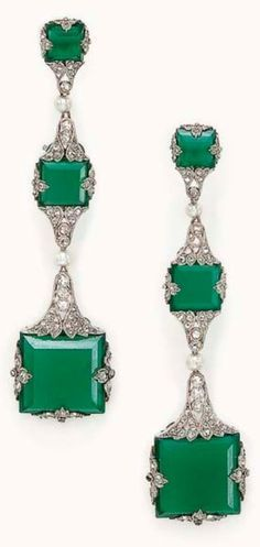 GHISO - A PAIR OF BELLE EPOQUE CHALCEDONY AND DIAMOND EAR PENDANTS, CIRCA 1918. Each designed as an articulated graduated series of square-cut green chalcedony, within pierced rose-cut diamond palmette surrounds, spaced by a seed pearl, mounted in platinum, signed Ghiso. #Ghiso #BelleÉpoque #earrings