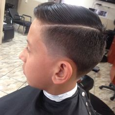 slick haircut with a quiff and whitewalls