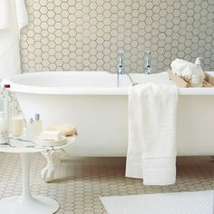 If having a patterned floor, medium to large tiles are better as small or mosaic tiles can make the bathroom look even smaller.