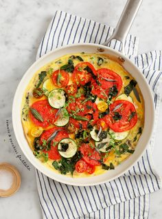 Tomato and Zucchini Frittata -- the tomatoes are roasted here, so even winter hothouse tomatoes will taste sweet! Try using all grape tomatoes in winter for the most intense flavor. Makes a wonderfully hearty meal for 3 on Phase 1 (no oil, 9 egg whites) or Phase 3 (use 3 eggs and 6 whites).