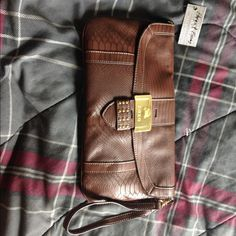 """Selling this """"New Xoxo brown clutch"""" in my Poshmark closet! My username is: larochelle. #shopmycloset #poshmark #fashion #shopping #style #forsale #Clutches & Wallets"""