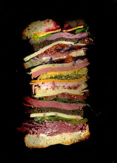 Homemade: The Dagwood. Pastrami, Roast Beef, Peppered Turkey, Honey Ham,Bologna, Cotto Salami, Provolone, American Cheese, Cheese Whiz, Swis, Pepper Jack, Muenster, Cheddar, Alfalfa Sprouts, Tarragon, Pickles, Red Cabbage, Horseradish with Beets, Mayo, Mustard, Sun Dried Tomatoes, Fresh Tomatoes, Lettuce, Baby Lettuce, Shredded Carrots, Purple Onion, Bacon Bits, on an Onion Roll, White Bread, Dark German Wheat Bread, and Potato Bread.