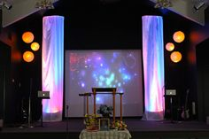 church stage idea hula hoops and sheer fabric.