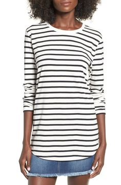 Horizontal stripes add nautical charm to a supersoft cotton-blend tee cut with a long shirttail hem and scrunchable long sleeves.
